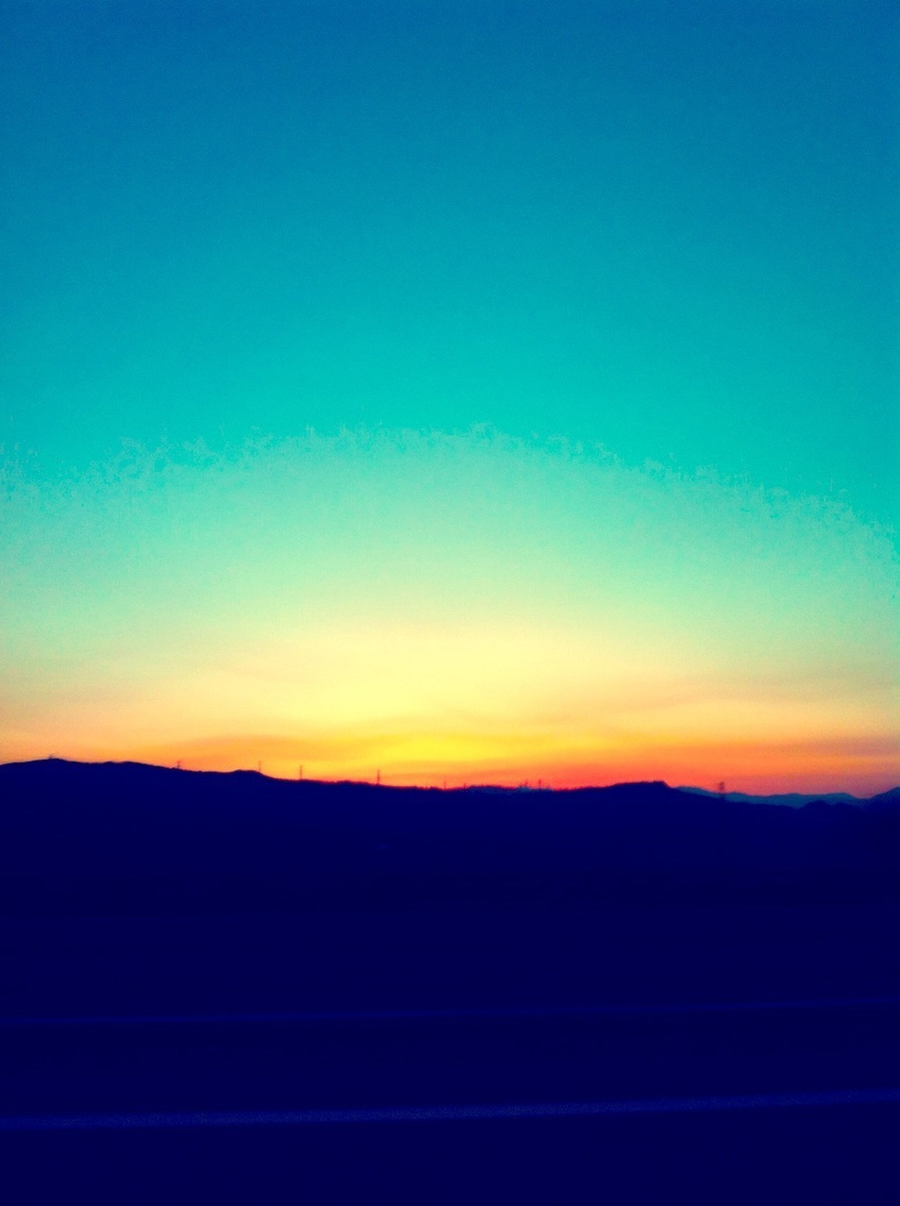 copy space, sunset, silhouette, scenics, tranquil scene, tranquility, blue, clear sky, beauty in nature, mountain, nature, idyllic, orange color, dusk, mountain range, landscape, sky, outdoors, majestic, no people