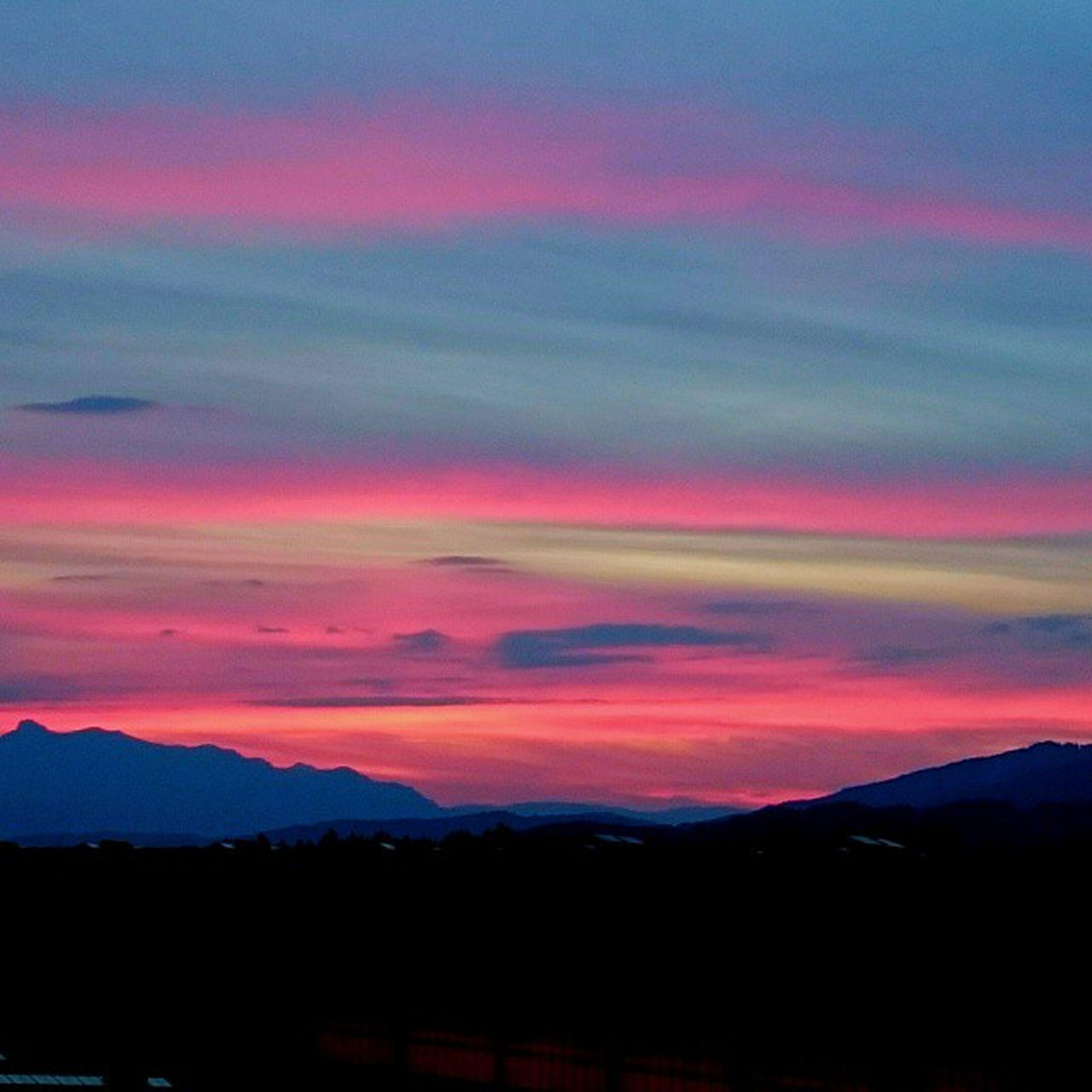 sunset, mountain, scenics, tranquil scene, beauty in nature, tranquility, silhouette, sky, mountain range, orange color, cloud - sky, landscape, nature, idyllic, dramatic sky, dusk, cloud, majestic, non-urban scene, cloudy