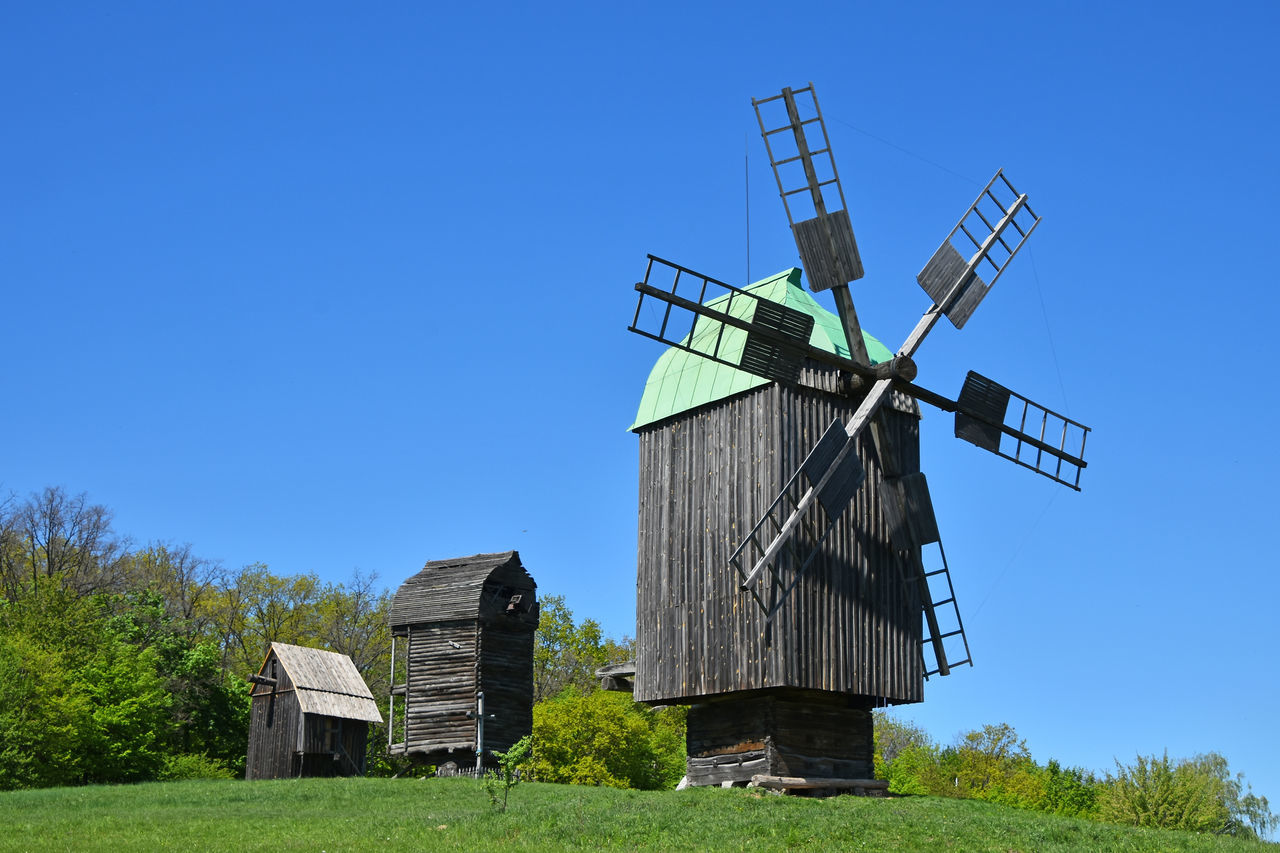 Vintage wooden windmill Antique Architecture Authentic Blue Day European  Folk Grass Nature No People Old Original Outdoors Pirogovo Sky Traditional Ukrainian  Vintage Wind Mill Windmill Windmills Wooden