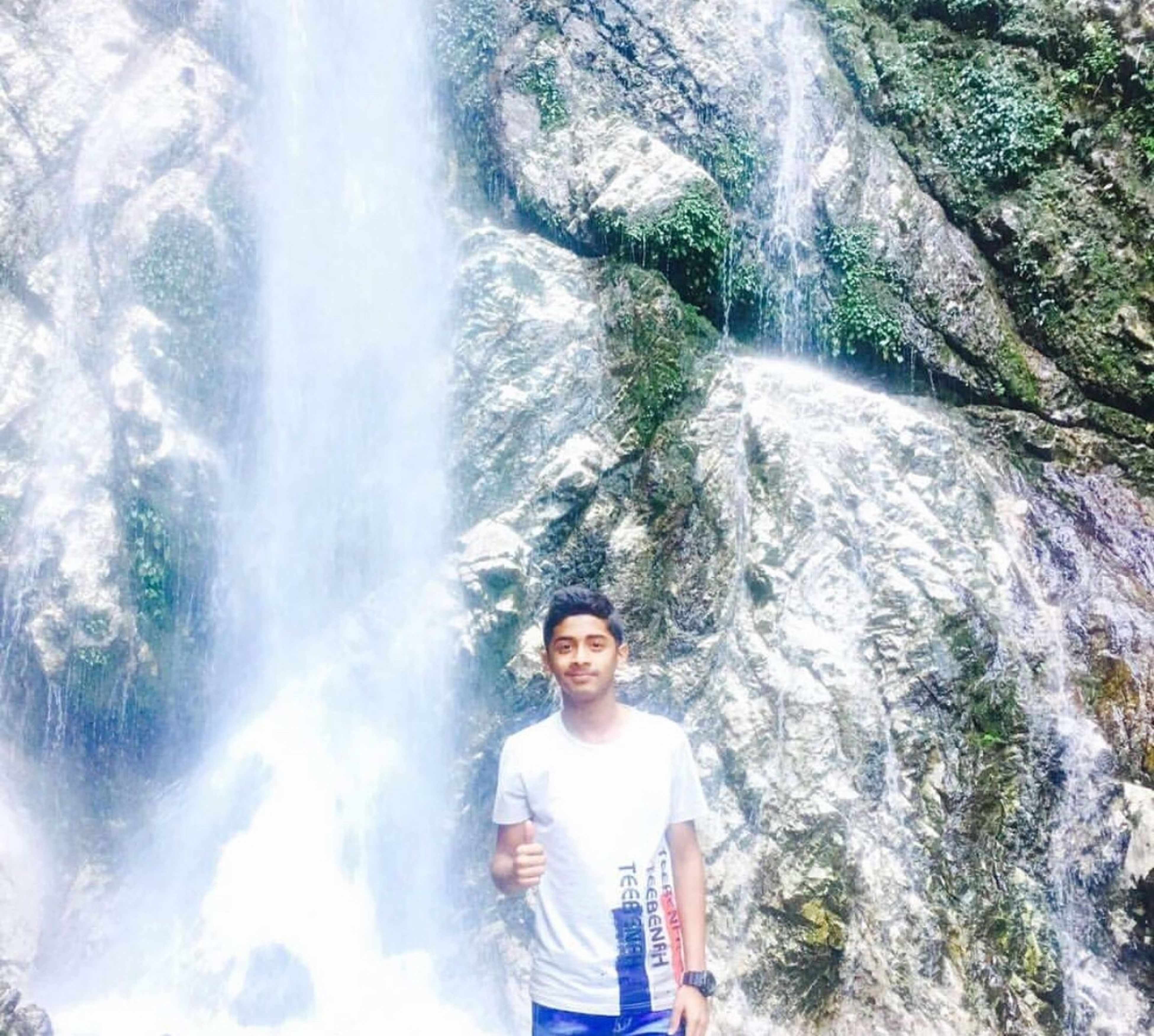 waterfall, one person, adults only, day, smiling, water, one man only, looking at camera, outdoors, people, portrait, motion, happiness, holding, nature, standing, only men, adult, young adult