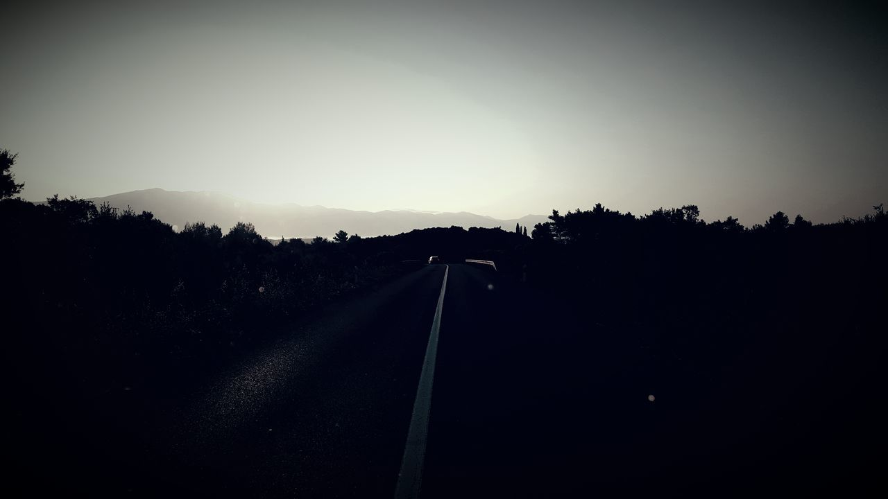 road, transportation, no people, silhouette, tree, tranquil scene, outdoors, tranquility, the way forward, sky, landscape, day, clear sky, nature, scenics, sunset, beauty in nature