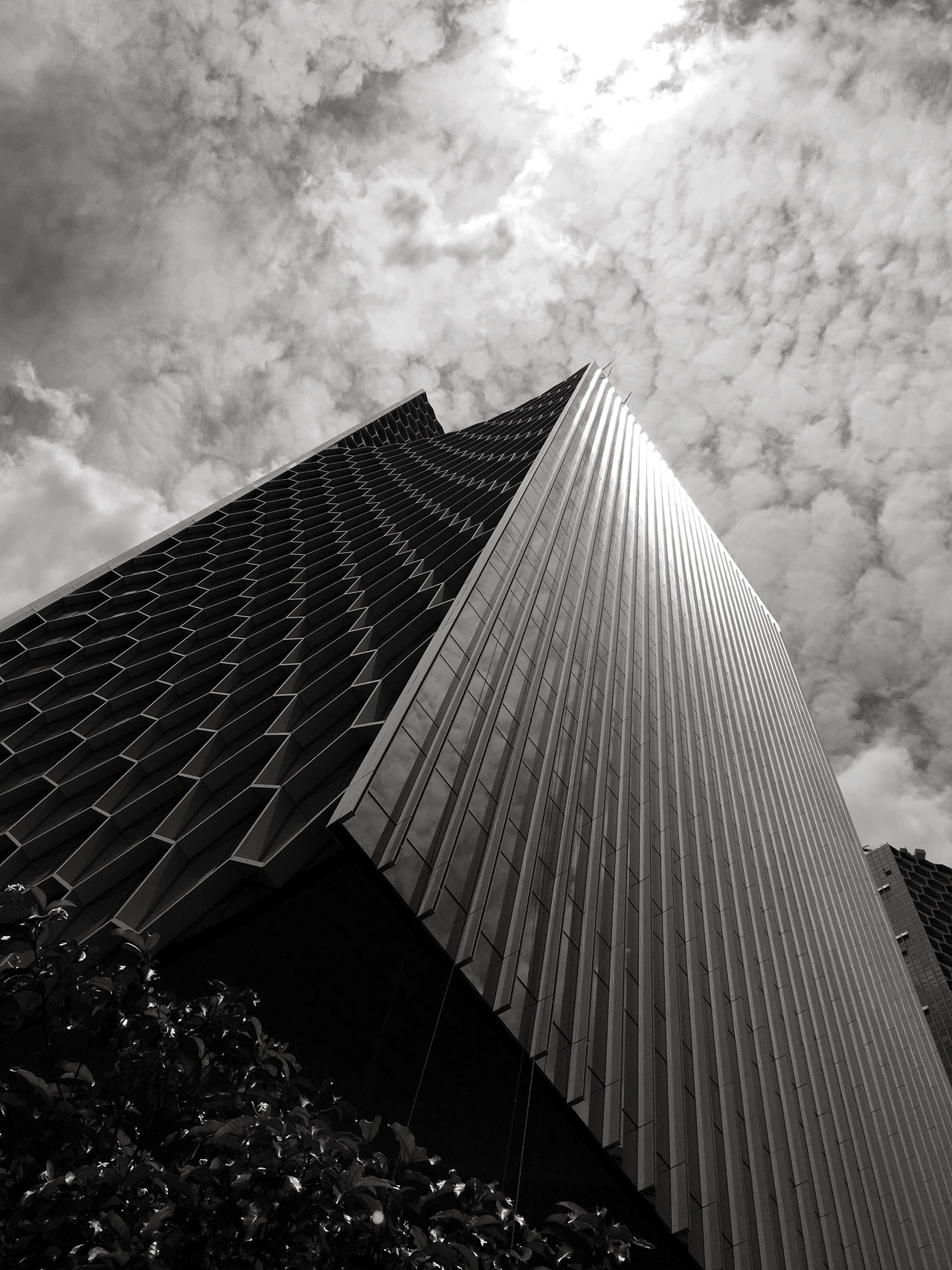 Modern skyscraper in black and white. Architecture Background Backgrounds Black And White Building Building Exterior Buildings Buildings & Sky Built Structure City Cityscape Cloud Clouds And Sky Construction Construction Industry Construction Site Day Low Angle View Modern No People Outdoors Pattern Reflection Sky Skyscraper