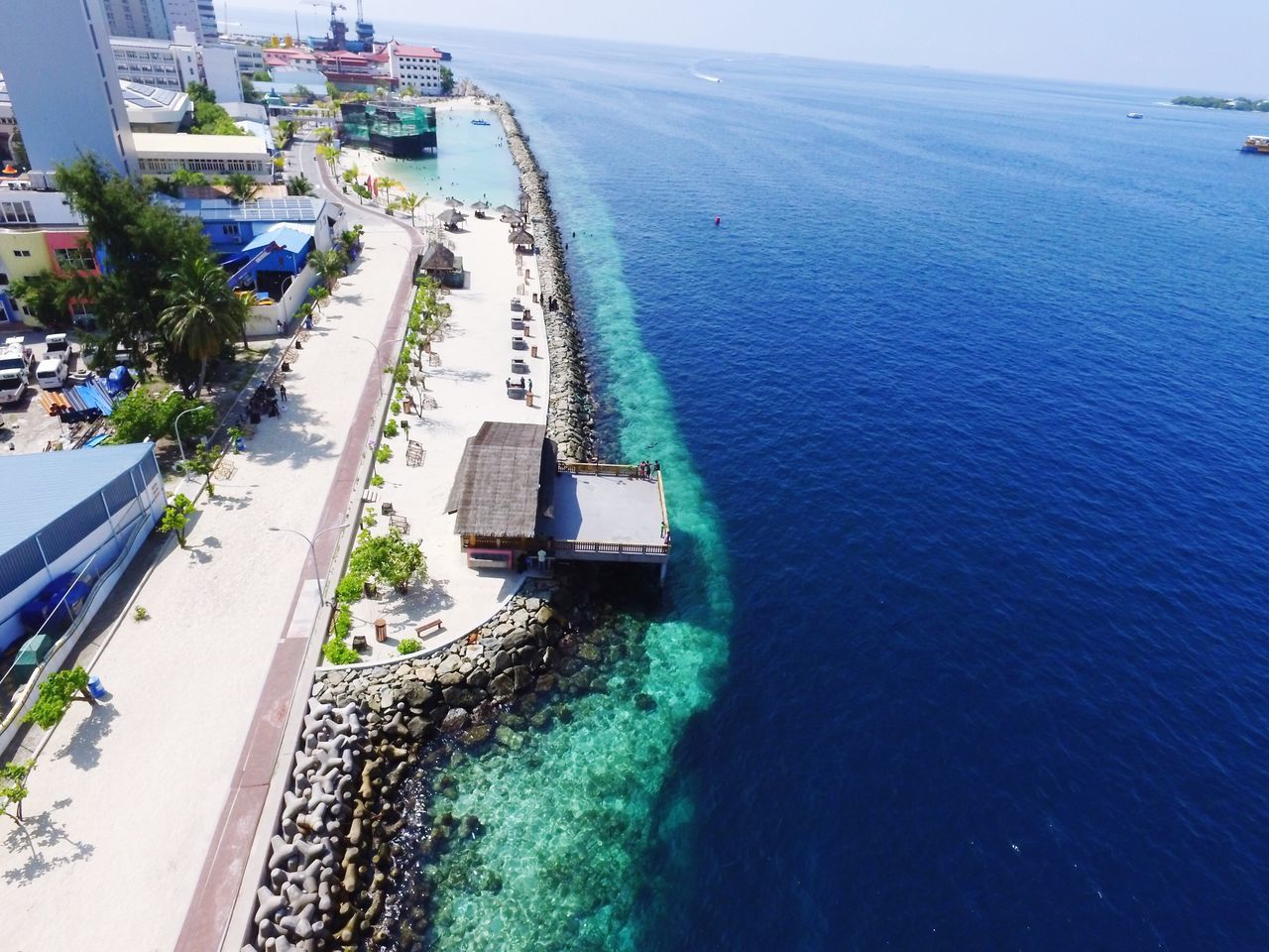 water, sea, high angle view, architecture, built structure, day, transportation, road, outdoors, building exterior, nature, no people, horizon over water, blue, scenics, nautical vessel, beauty in nature, sky, city