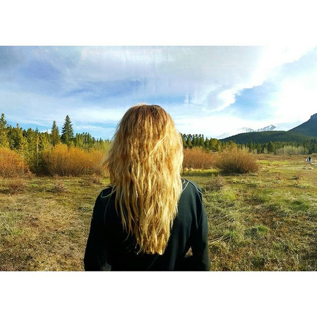 real people, one person, sky, blond hair, rear view, landscape, field, nature, leisure activity, women, cloud - sky, day, scenics, lifestyles, tranquil scene, outdoors, young women, tranquility, young adult, beauty in nature, tree, adult, people