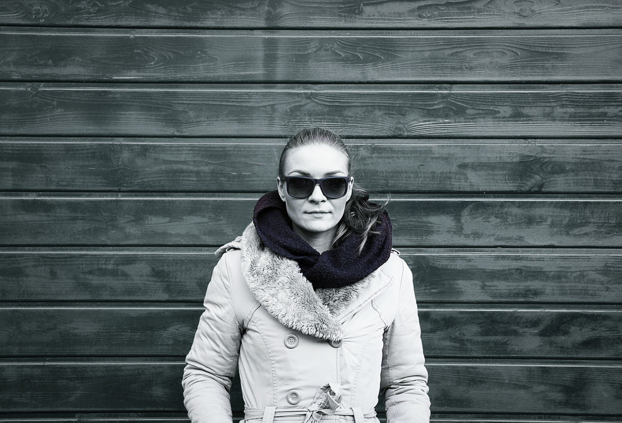 Looking At Camera Portrait Sunglasses Adults Only Adult Standing Outdoors One Person People Women Around The World Minimalism Minimal Drastic Edit Monochrome Symmetry Portrait Of A Woman Woman Warm Clothing Winter Urban Real People Wooden Texture Wood Wooden Background EyeEm Gallery