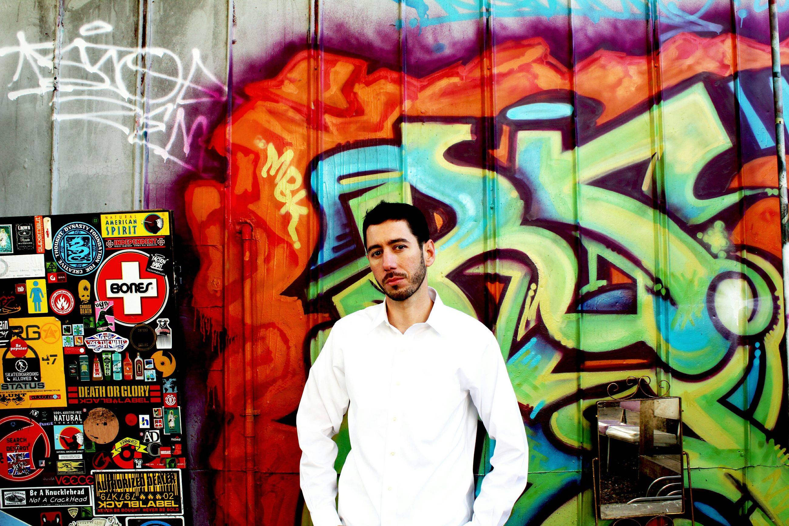 art, creativity, art and craft, graffiti, human representation, wall - building feature, multi colored, front view, looking at camera, portrait, indoors, painting, young adult, casual clothing, person, built structure