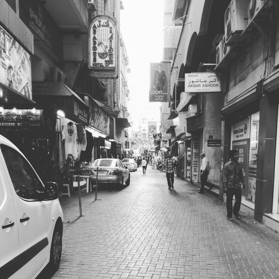 Manama Souq Street Walking City Life Building Exterior Architecture Outdoors Commercial Sign Narrow Building The Way Forward Sky Day Built Structure City Market Marketplace Busy Street First Eyeem Photo