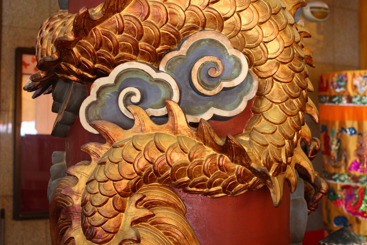 art and craft, statue, indoors, focus on foreground, no people, close-up, sculpture, day, chinese dragon