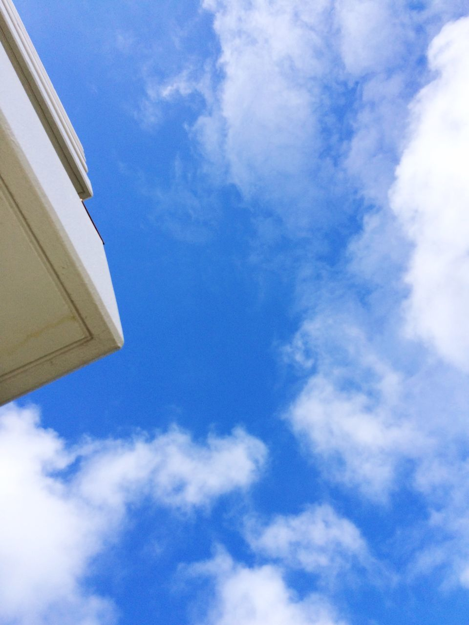 low angle view, sky, cloud - sky, blue, day, no people, outdoors, building exterior, nature, beauty in nature, built structure, architecture