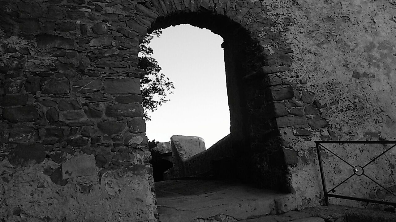 The Secret Spaces Arch Castle History Architecture Blackandwhite Photography TheMinimals (less Edit Juxt Photography) Monocrome Black And White Shadows & Lights Poetry & Photography Language The Beauty In Simplicity In Castiglione Della Pescaia Tuscany Italy Doors From The Past Stone Material Building Exterior Old Ruin Break The Mold