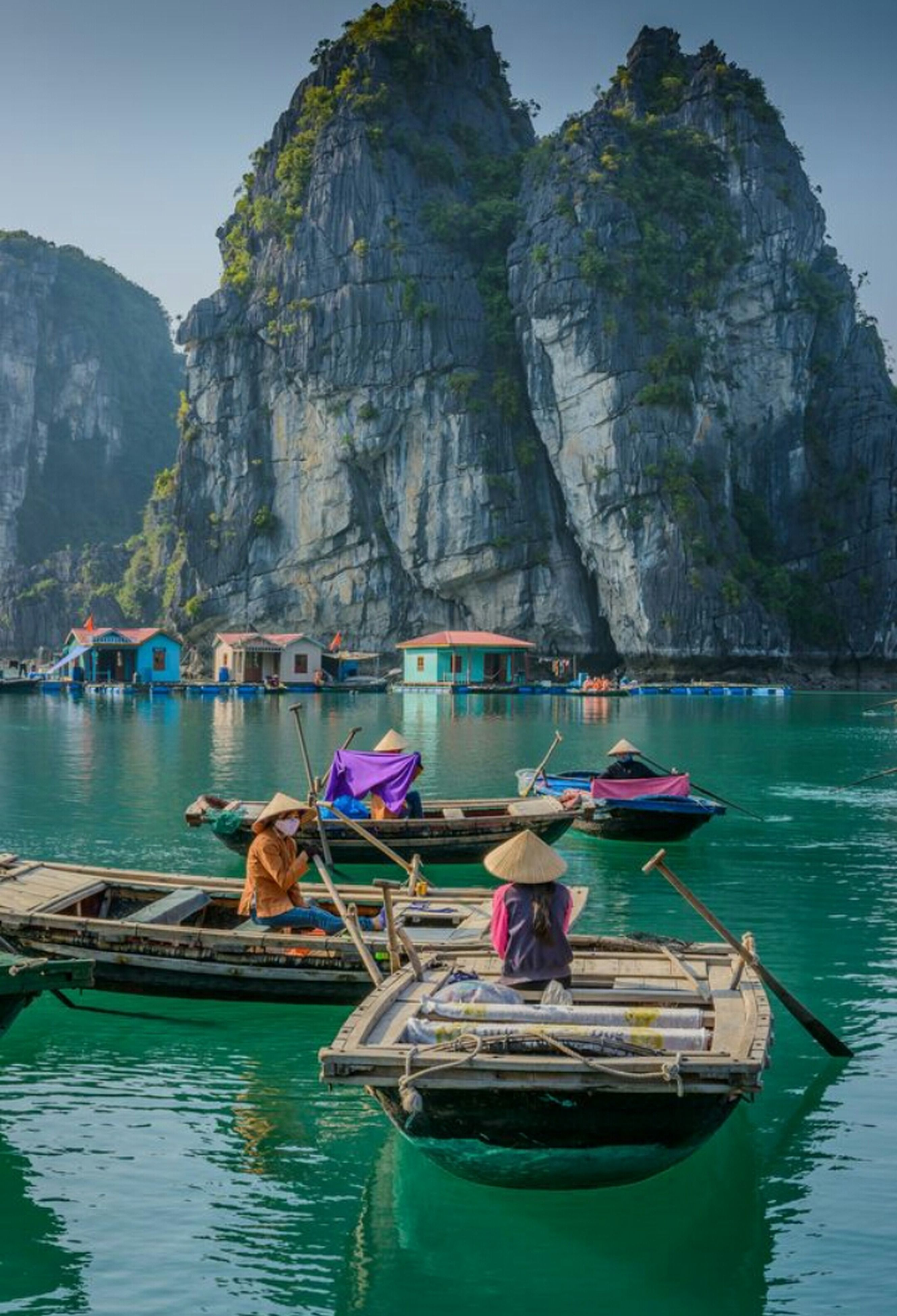 nautical vessel, transportation, mode of transport, moored, rock formation, mountain, rock - object, outdoors, day, oar, water, cliff, travel destinations, scenics, nature, sea, gondola - traditional boat, rowing, adult, longtail boat, people, one person, adults only