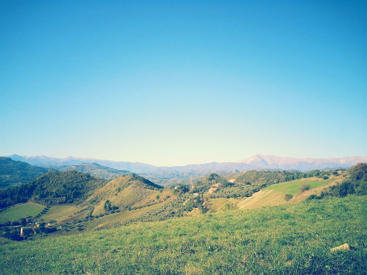 landscape, nature, beauty in nature, tranquil scene, scenics, field, mountain, tranquility, blue, copy space, rural scene, grass, no people, clear sky, agriculture, outdoors, mountain range, day, sky