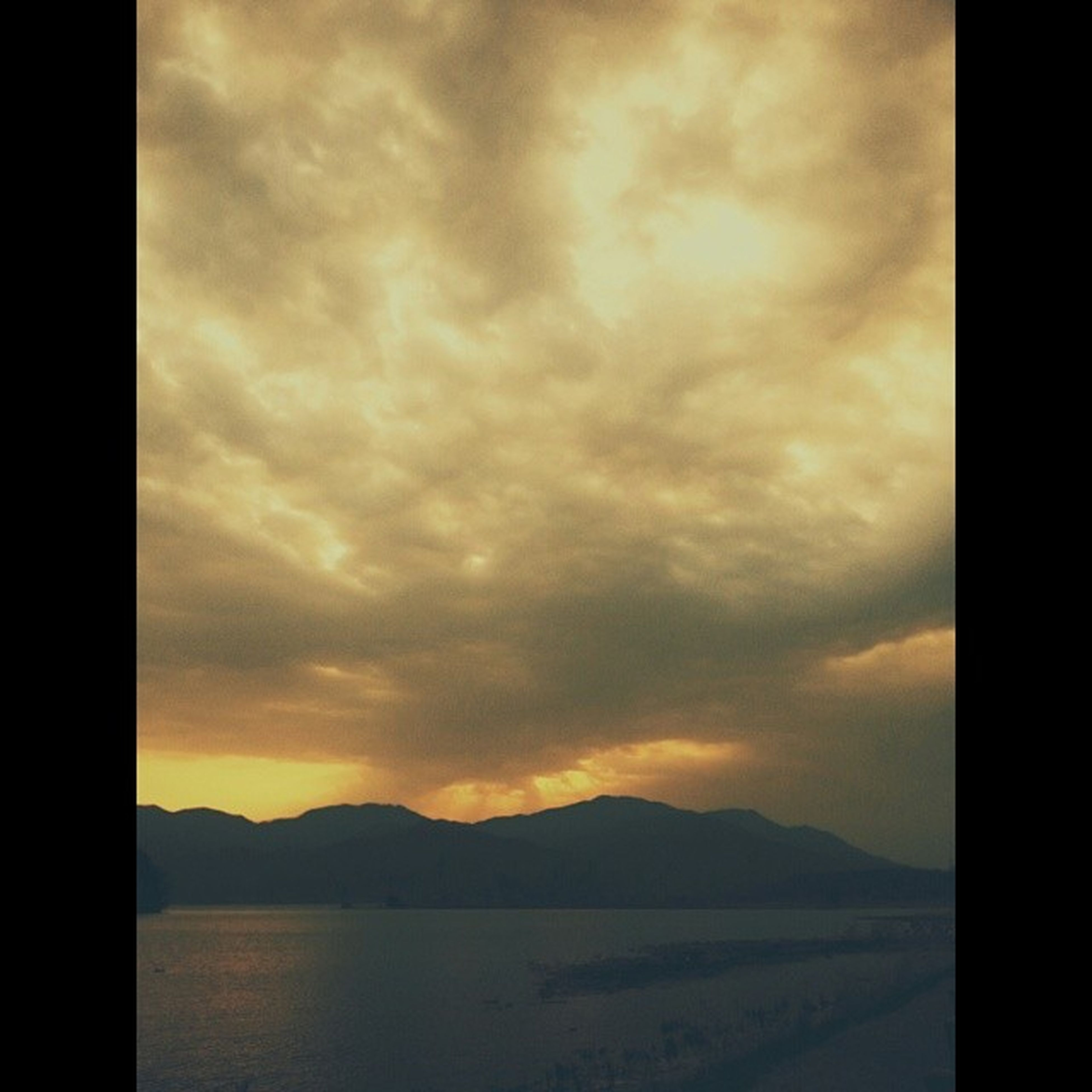 scenics, tranquil scene, sky, tranquility, beauty in nature, mountain, water, sunset, cloud - sky, nature, mountain range, idyllic, transfer print, sea, cloudy, cloud, silhouette, auto post production filter, lake, non-urban scene