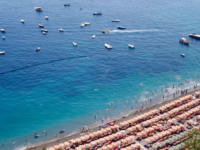 Amalfi Coast Beach Beach Photography Beauty In Nature Blue Boats Eye4photography  EyeEm Best Shots EyeEm Best Shots - Nature EyeEm Gallery EyeEm Nature Lover High Angle View Italia Italy Large Group Of People Nature Positano Sea Shore Summer Swimming Umbrella Vacations Warm Water