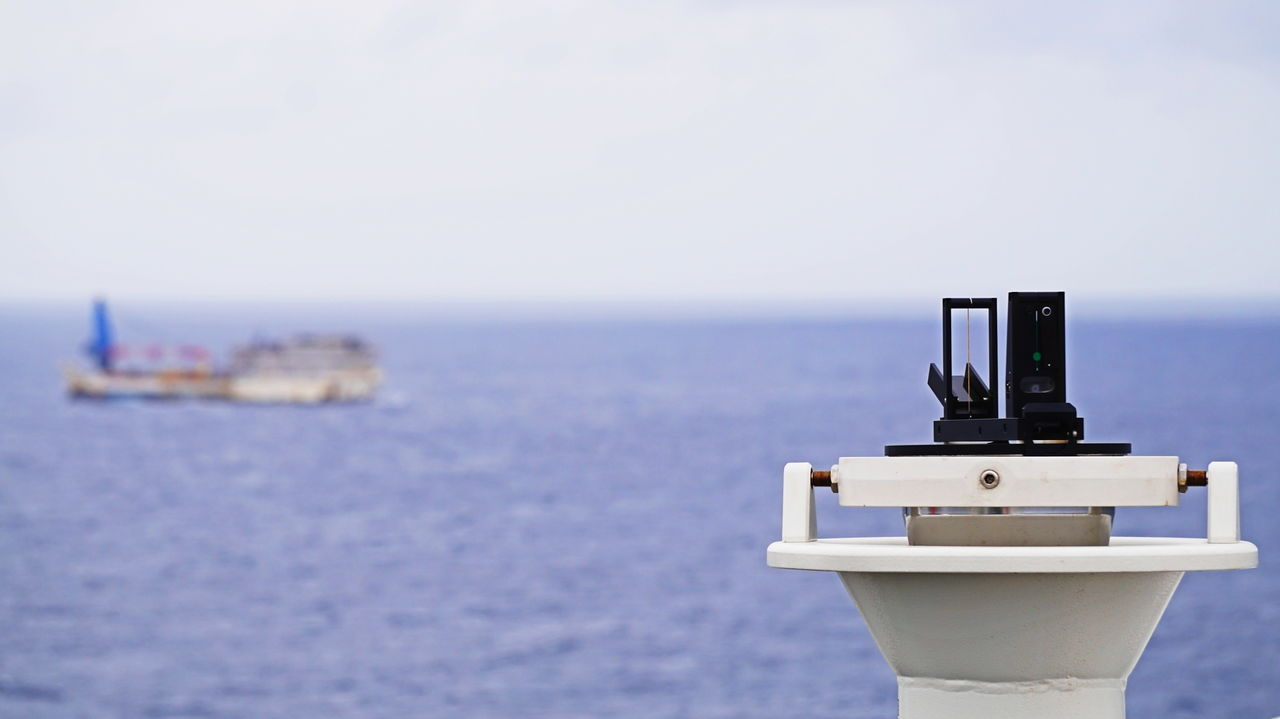 sea, water, horizon over water, nature, scenics, no people, close-up, focus on foreground, sky, coin-operated binoculars, beauty in nature, clear sky, day, outdoors