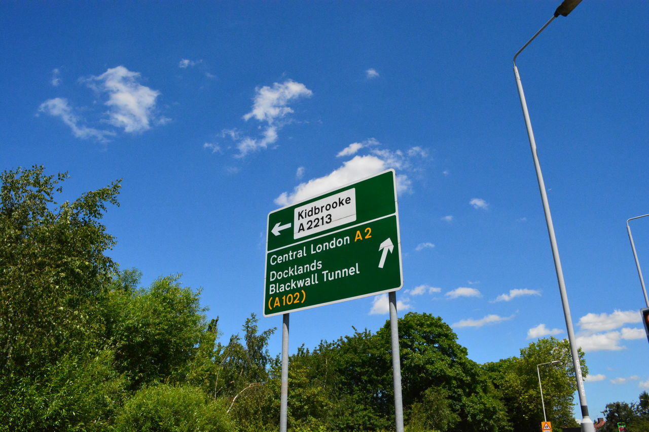 Road sign and lamp post