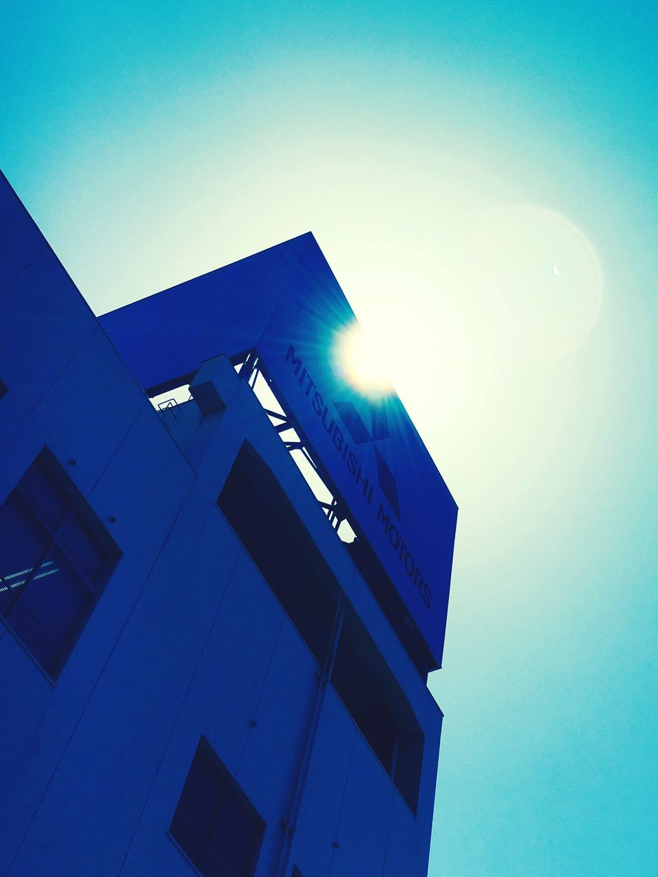 low angle view, built structure, architecture, blue, building exterior, clear sky, no people, illuminated, outdoors, moon, sky, modern, day