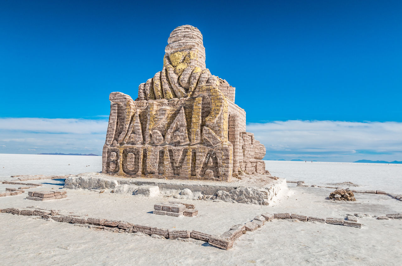Salar Uyuni in Bolivia Ancient Civilization Beach Beauty In Nature Blue Bolivia Bolivia Uyuni Day Desert Nature No People Outdoors Sal Salar Uyuni Salt Flat Sand Sculpture Sea Sky Statue Uyuni Uyuni Salt Flat White