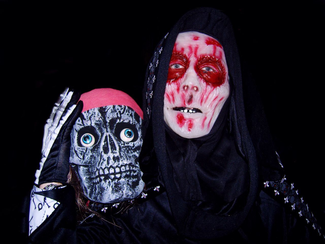 Halloween scene Spooky Horror Halloween Evil Face Paint Looking At Camera Portrait Stage Make-up Black Background Make-up Night Adult Black Color Clown People Mature Adult Disguise Shock Human Body Part Men