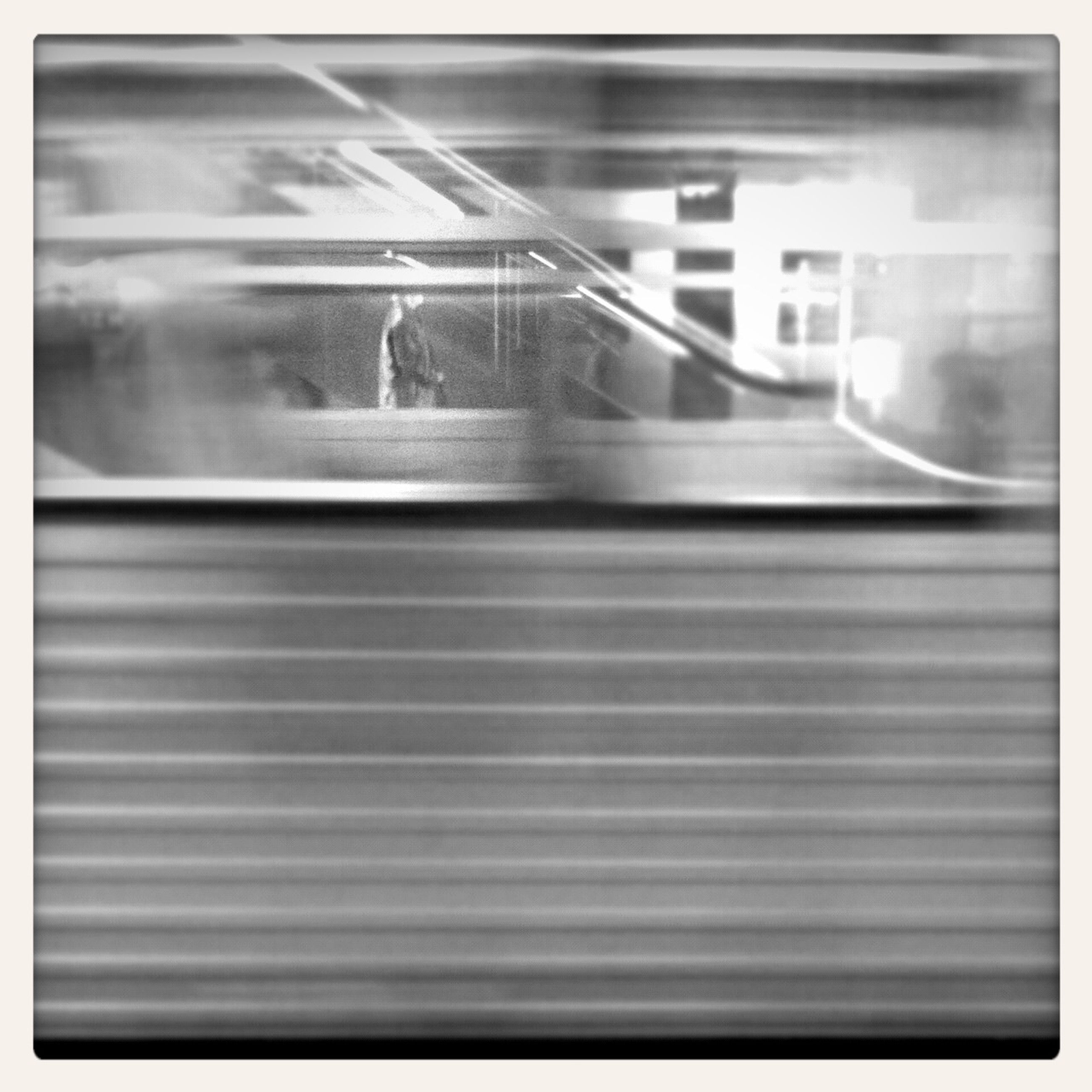 transfer print, indoors, auto post production filter, glass - material, reflection, transparent, window, blurred motion, motion, built structure, transportation, architecture, glass, no people, water, close-up, sunlight, day, long exposure, empty