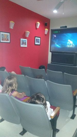 Thelilian watching rio in the theater at her new school. (: