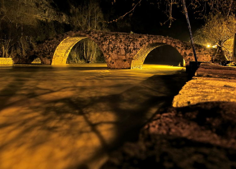 Arch Architecture Bridge - Man Made Structure Built Structure Connection Illuminated Nature Night Old Bridge Outdoors River At Night Tunnel Water Water Reflections