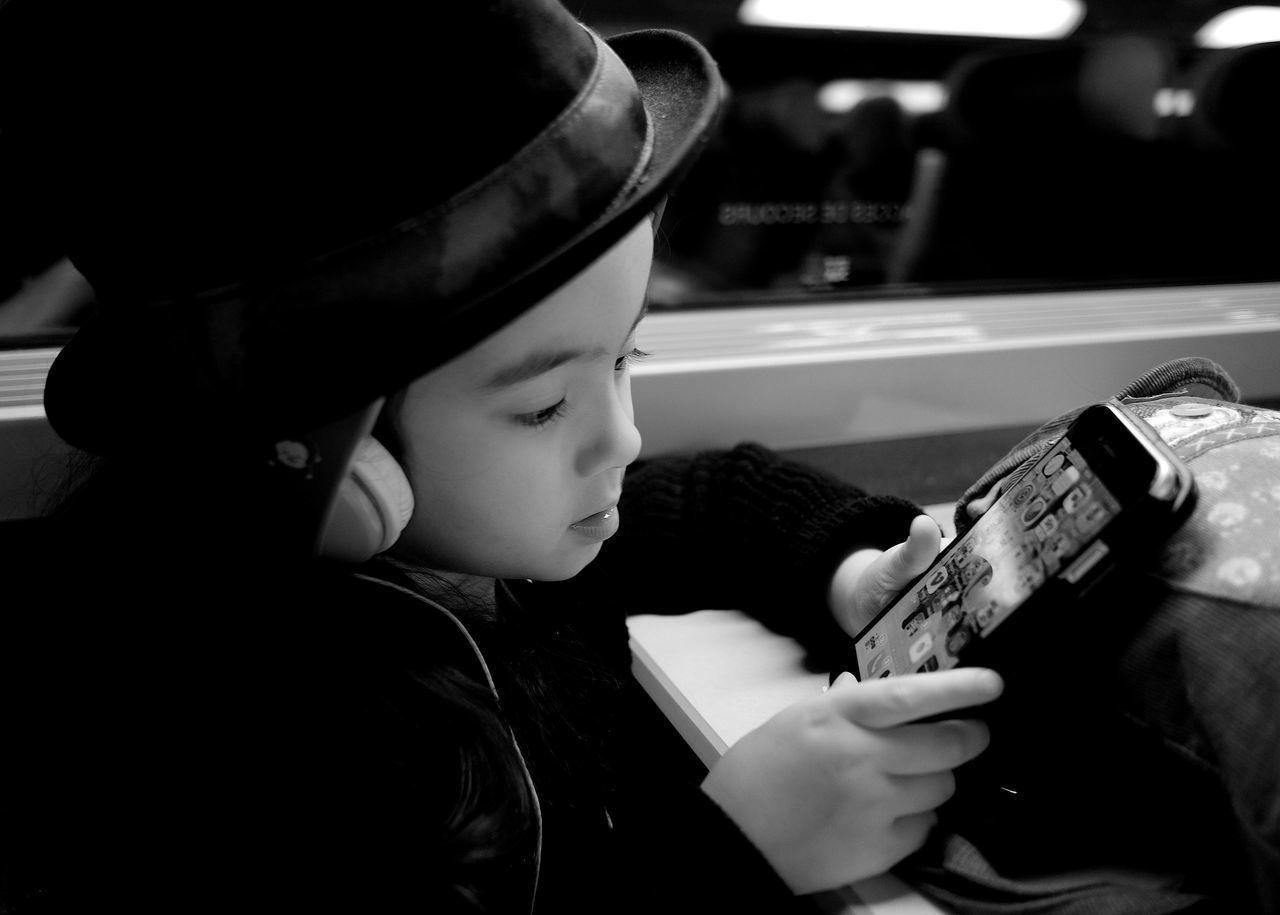Fujifilm Fujixe2 Children Child IPhone Holding A Phone Daughter Hat Traveling Onthetrain Playing Listening To Music Blackandwhite Japanese  Hats Wearing Hat Headphones Monochrome Kidsphotography Kid