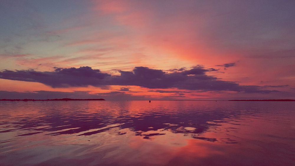 sun set Color Sunset Magic #view Sunset Water Scenics Beach Sea Tranquility Reflection Outdoors Nature No People Red Beauty In Nature Sky Landscape Horizon Over Water Low Tide Day Colour Your Horizn