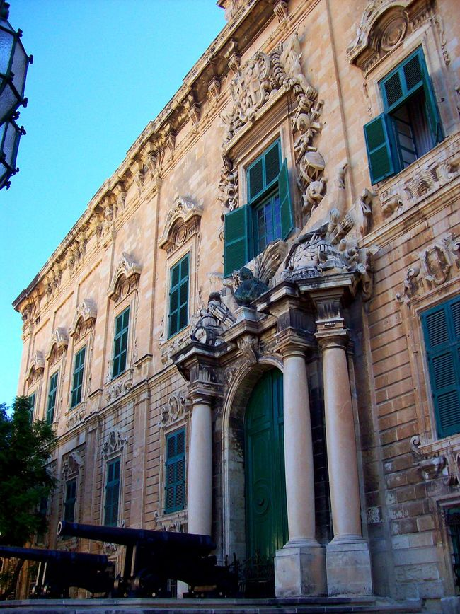 Arcade Arch Architectural Column Architectural Feature Architecture Blue Building Exterior Built Structure City Life Clear Sky Colonnade Day Façade Historic History Low Angle View Malta No People Outdoors Sky The Past Window