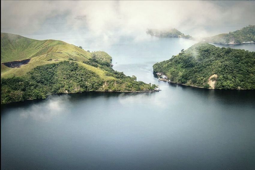 Lake Sentani in Papua just before touch down. Aerial Photography, Landscape, Blue Water, Blue Lake, Jayapura