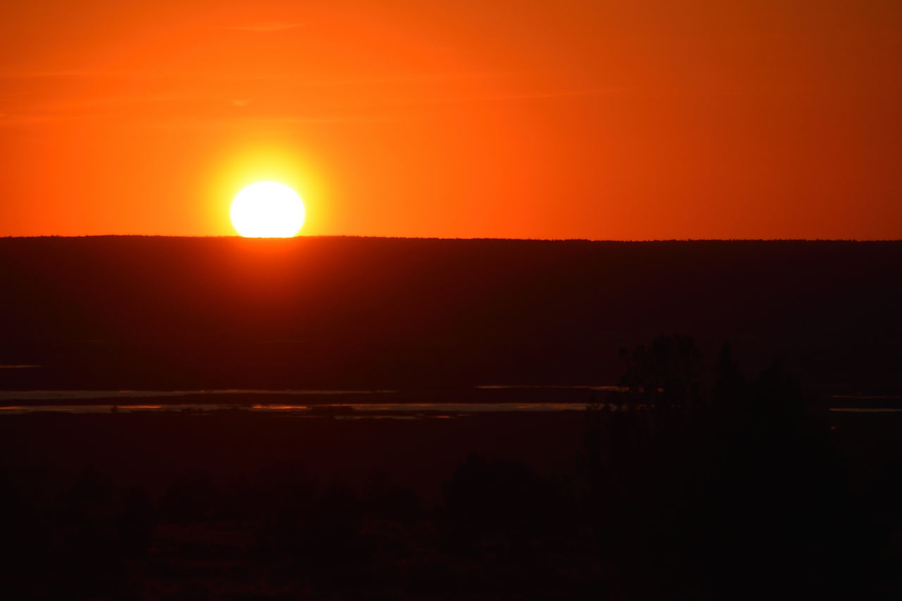Sunset Over Devil's Garden Astronomy Beauty In Nature Day Gold Colored Nature No People Orange Color Outdoors Scenics Silhouette Sky Sun Sunset Tranquility