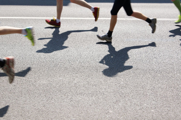 Anonymous Asphalt Athlete Feet Jogging Legs Low Section Marathon People Runners Running Shadow Sports Street Unrecognizable Person