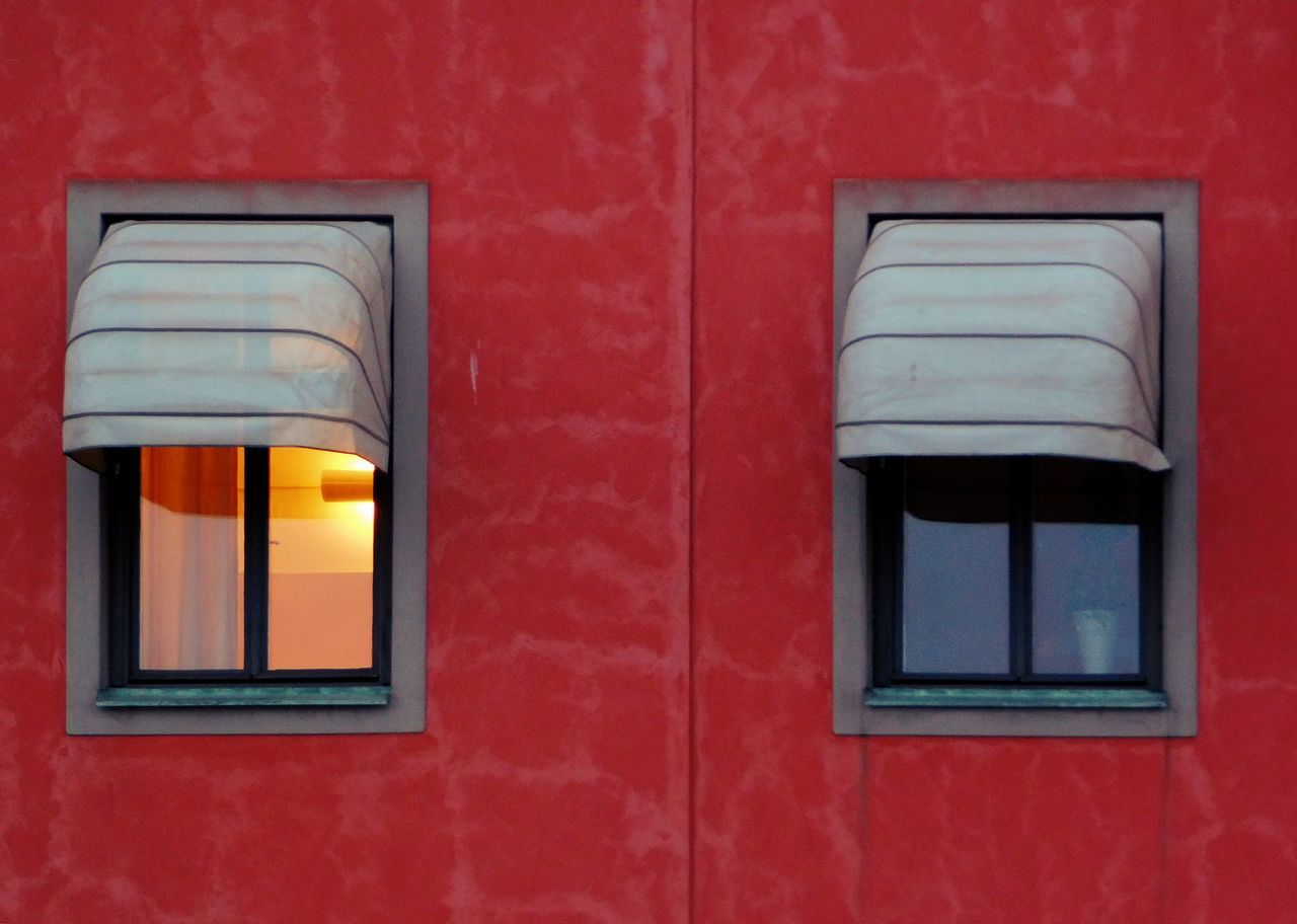 Wink. Architecture City Close Up Close-up Close‐up Photography Day Door Dusk Dusk In The City Finding New Frontiers Gamla Stan Light Lights Nightfall No People Outdoors Red Travel Destinations Twilight Window Wink