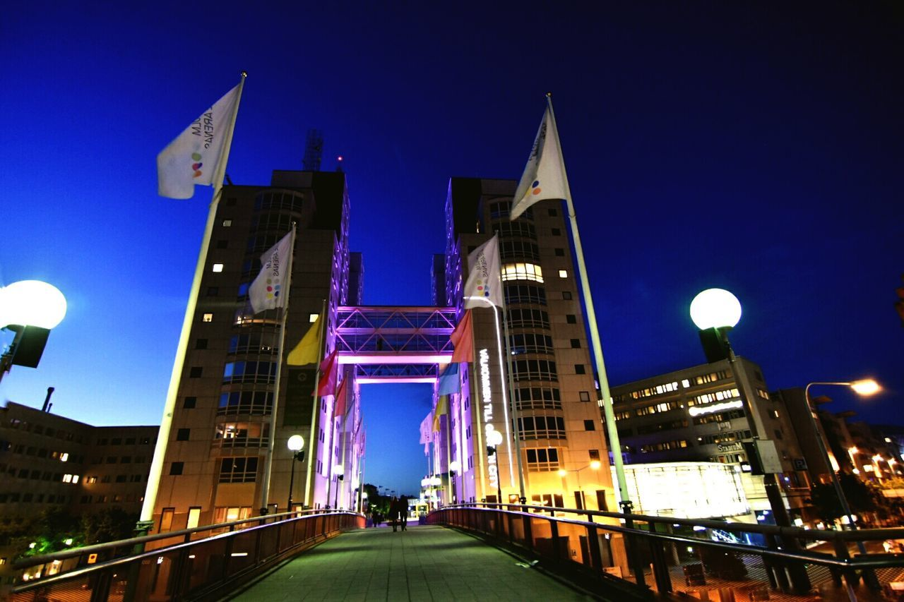 night, illuminated, architecture, built structure, building exterior, low angle view, street light, bridge - man made structure, outdoors, the way forward, sky, city, real people