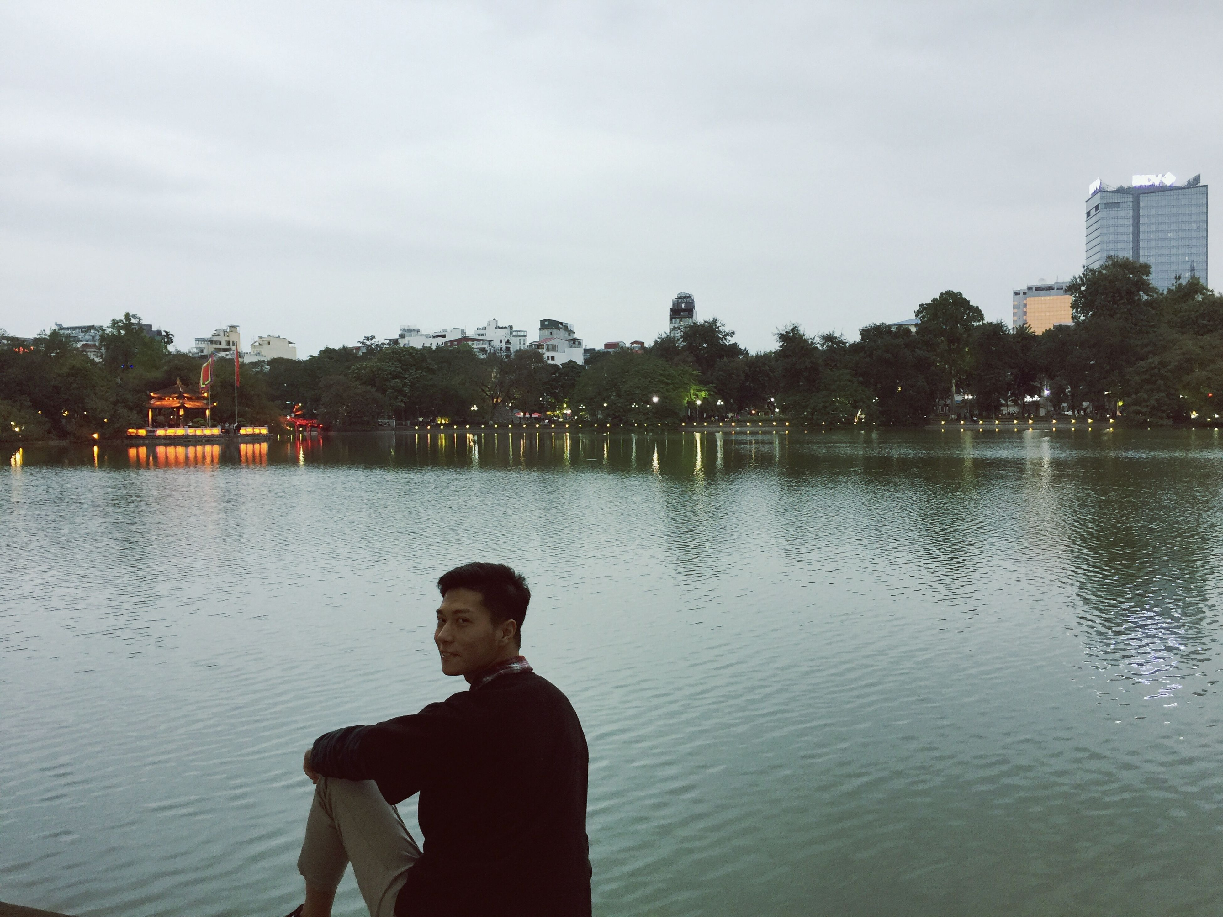 water, one person, reflection, real people, sky, young adult, cloud - sky, outdoors, men, nature, day, only men, one man only, architecture, people, adults only, adult