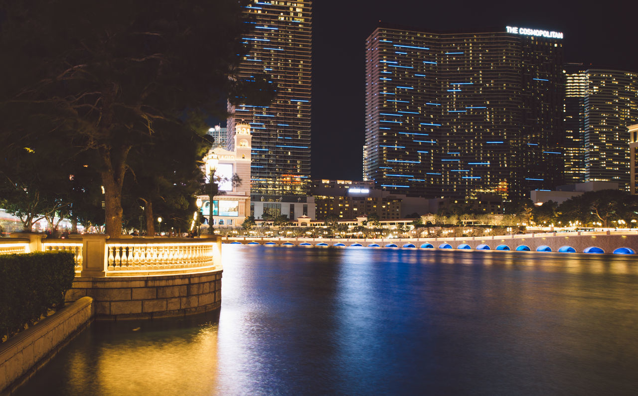night, illuminated, architecture, building exterior, built structure, transportation, city, nautical vessel, mode of transport, waterfront, river, water, tree, no people, outdoors, skyscraper, nature, cityscape, sky
