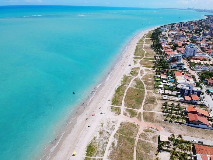 Sea Beach Water High Angle View Aerial View Sand Day Outdoors Nature Sky No People Vacations Beauty Multi Colored Tree Horizon Over Water