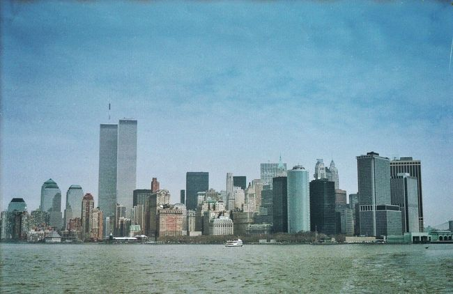 1999 Architecture Blue Building Exterior Built Structure City Cityscape Clear Sky Downtown District Financial District  Horizontal Modern No People NYC Outdoors Skyscraper Travel Destinations Twin Towers Urban Skyline Water World Trade Center WTC