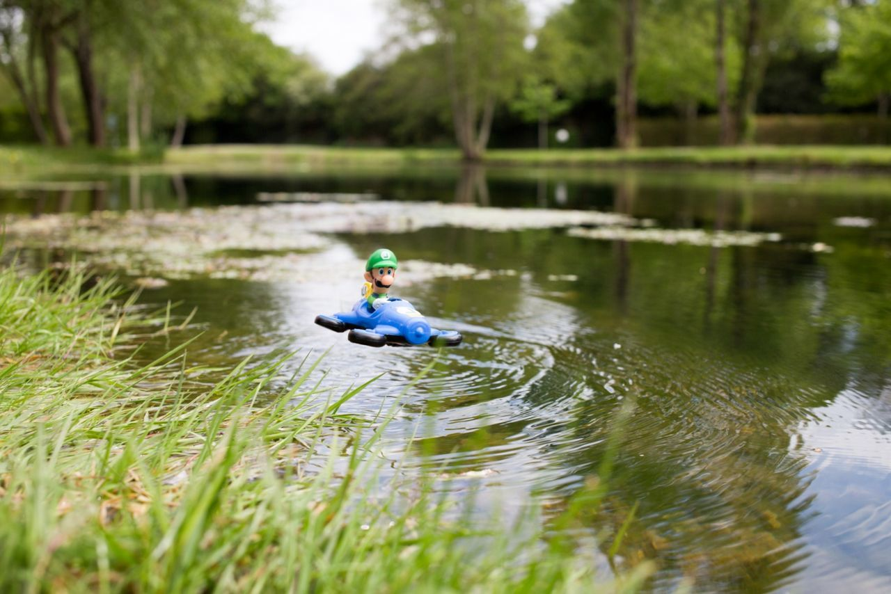 Drone  Luigi Mariokart Water One Person Outdoors Lake Fishing Day Sitting Nature Adult People Headwear Adults Only One Man Only Protective Workwear Full Length Oar Only Men