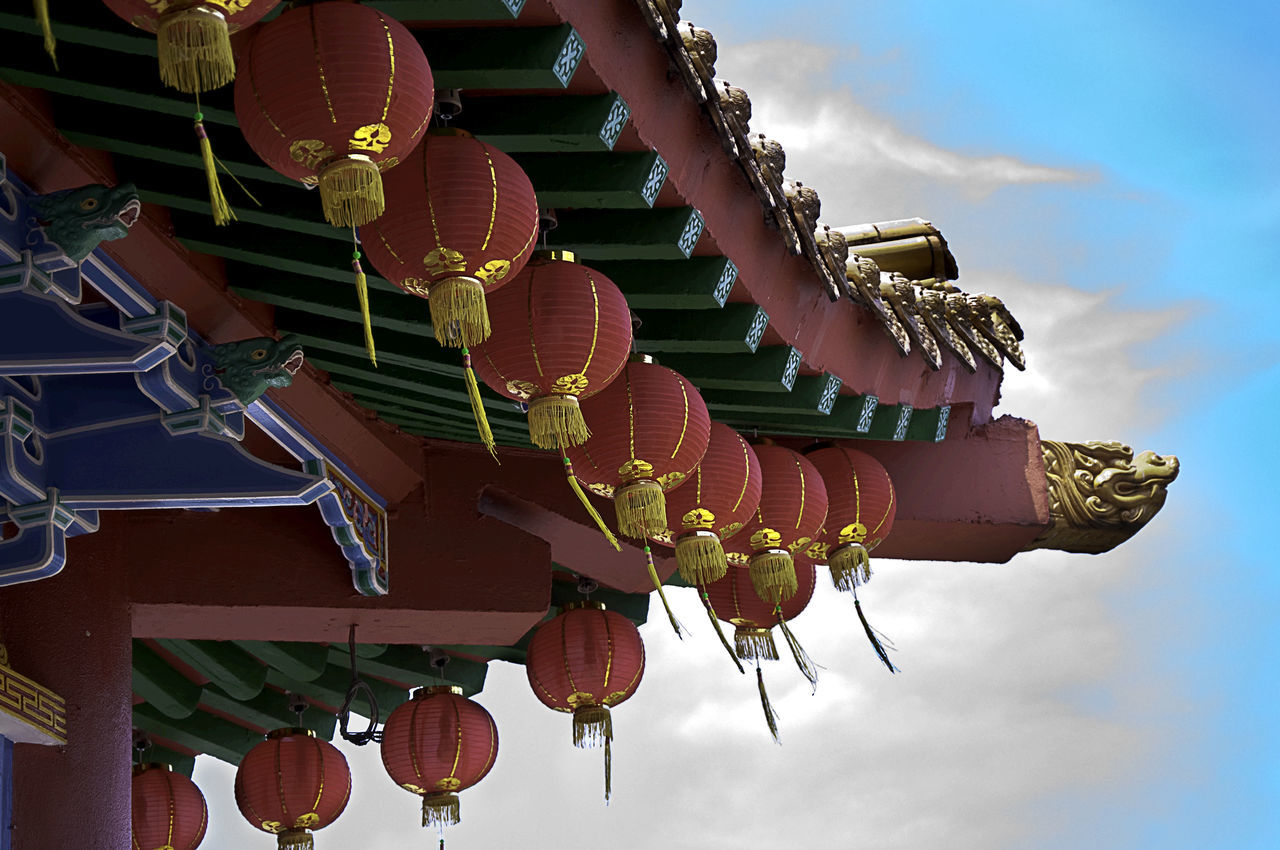 religion, spirituality, cultures, hanging, place of worship, low angle view, tradition, traditional festival, architecture, no people, sky, outdoors, lantern, cloud - sky, built structure, travel destinations, building exterior, day