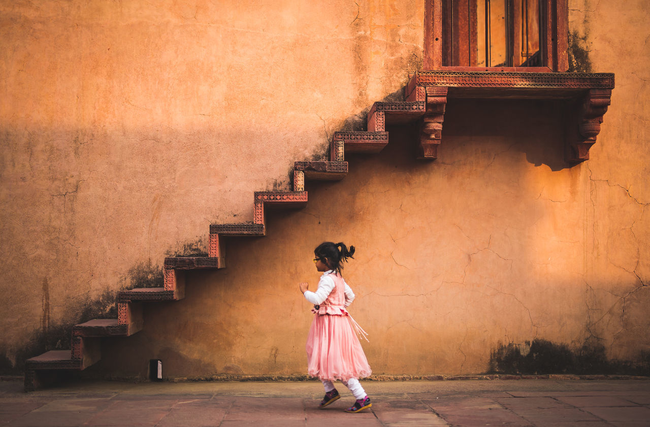 Girl Running by Stairs. Agra Architecture Architecture ASIA Beautiful Composition Culture Day DSLR Frame Girl Historical Building India One Person Outdoors Ruins Running Sigma Stairs Sun Symmetry Temple Travel Destinations Warm