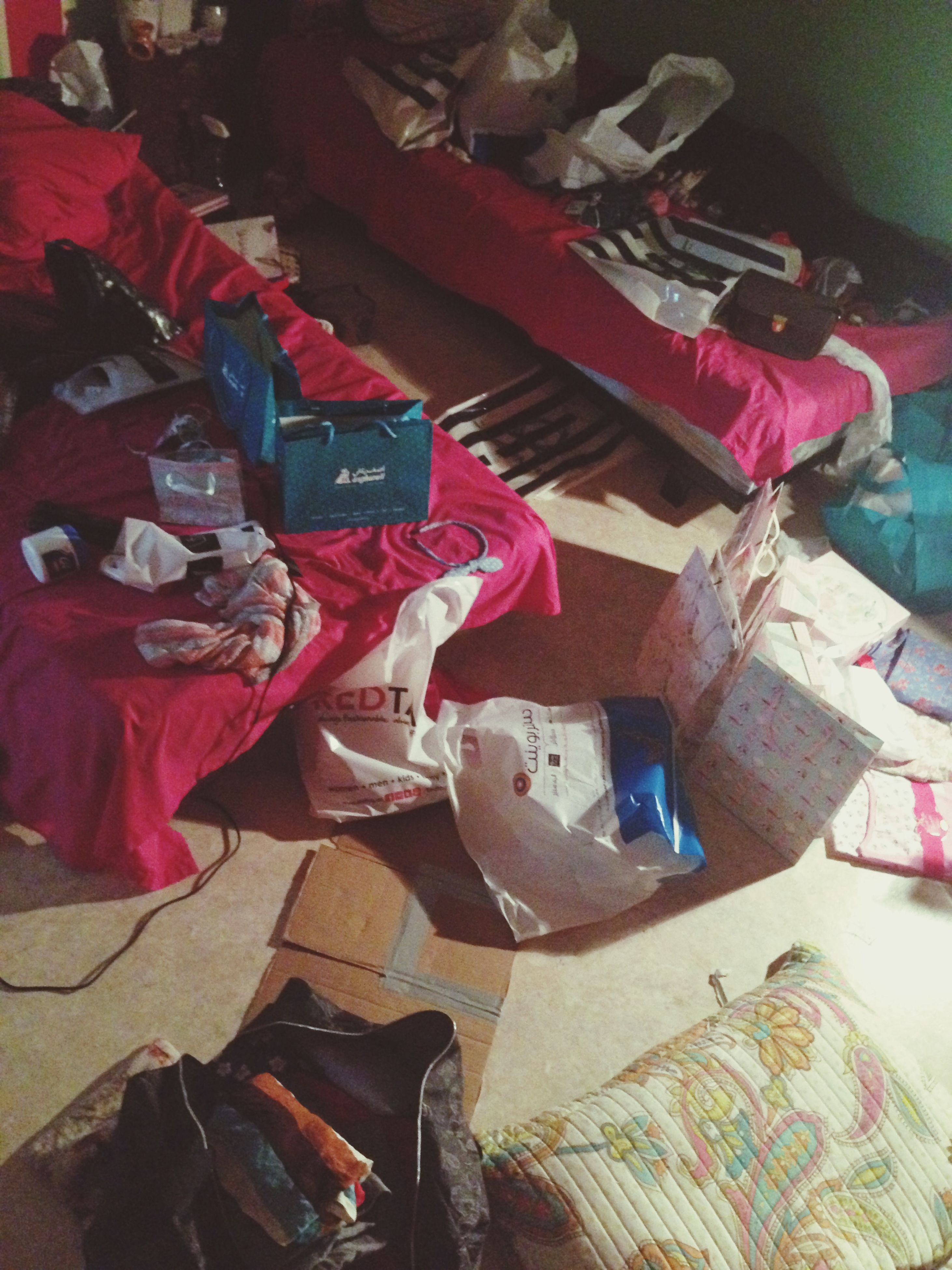 indoors, high angle view, variation, still life, large group of objects, clothing, choice, abundance, home interior, multi colored, table, paper, shoe, bed, absence, book, music, stack, textile, fashion