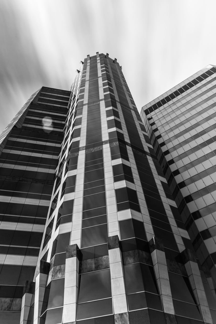 architecture, building exterior, built structure, skyscraper, low angle view, modern, city, outdoors, tower, day, travel destinations, corporate business, sky, tall, no people