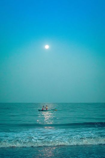 Fishing under the Full Moon. Beauty In Nature Clear Sky Day Fishing Full Moon Horizon Over Water Jet Boat Leisure Activity Lifestyles Men Moon Nature Nautical Vessel Outdoors People Real People Scenics Sea Sky Two People Vacations Water Waterfront The Great Outdoors - 2017 EyeEm Awards