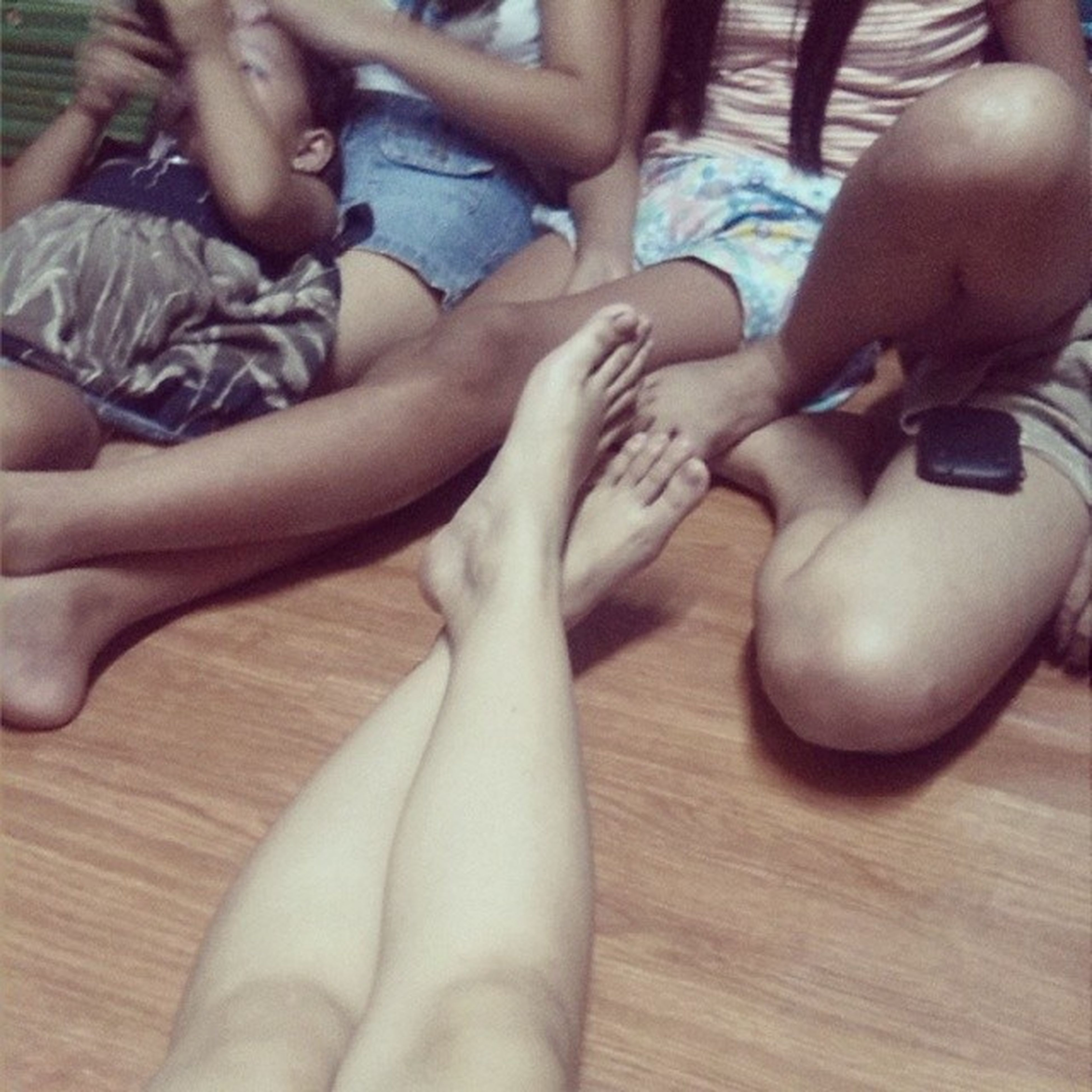 low section, lifestyles, person, leisure activity, indoors, togetherness, sitting, human foot, men, relaxation, bonding, barefoot, high angle view, friendship