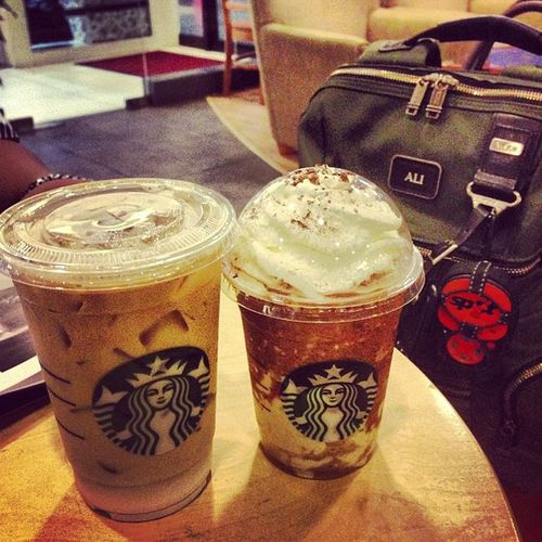 While waiting for our flight back to KB...Starbucks Tumi Spotme Findspotme tods