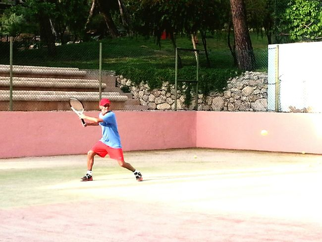 Father playing tennis