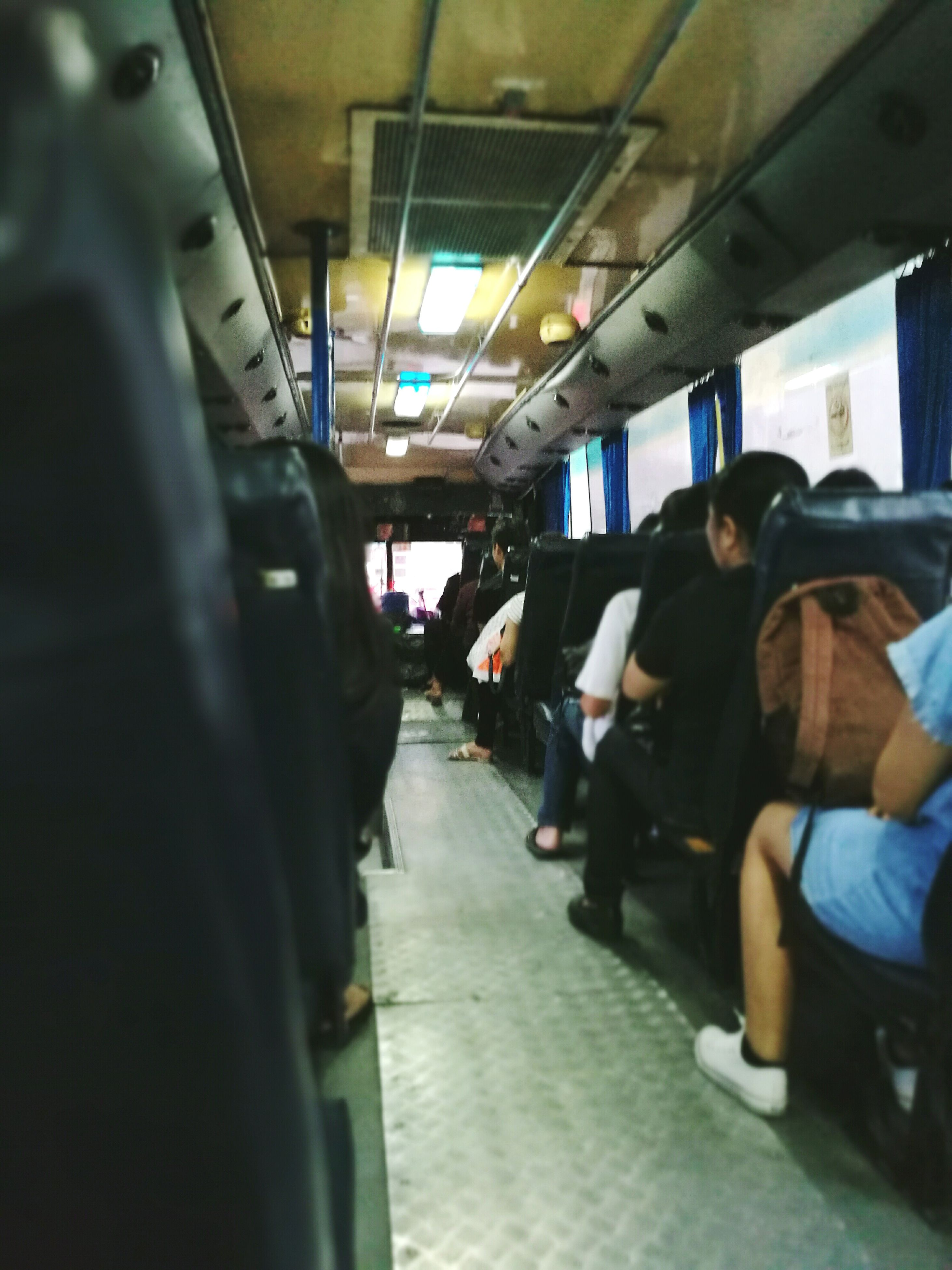 transportation, mode of transport, passenger, vehicle interior, real people, travel, public transportation, vehicle seat, large group of people, lifestyles, indoors, journey, women, men, train interior, people, adults only, day, adult