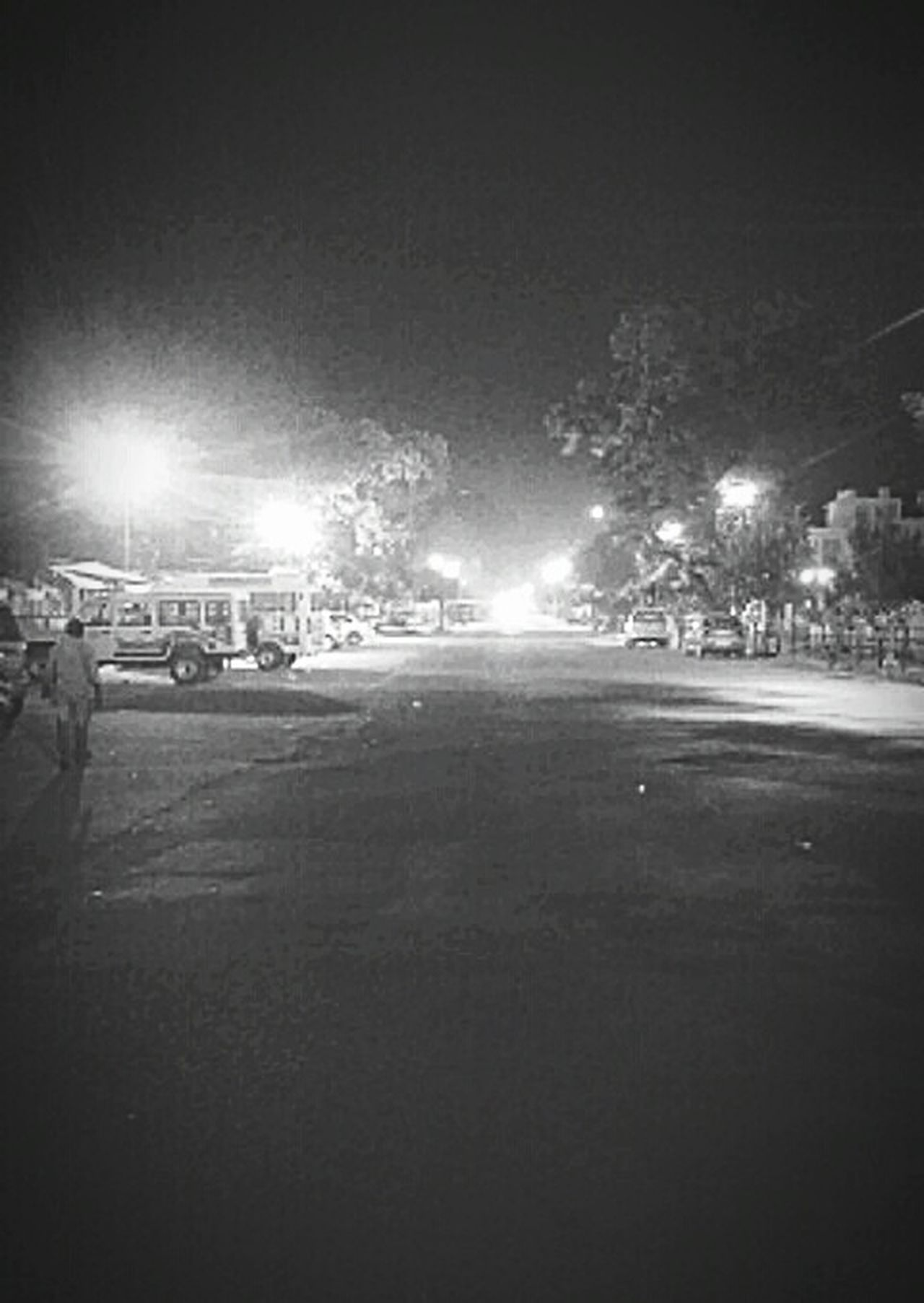 Monochrome Photography This Week On Eyeem The Way Forward Street Light City Life People And Places Night Photography Every Picture Tells A Story INCREDIBLE INDIA<3 Walking Endlessly... Night Scene Endless Journey Black And White Photography