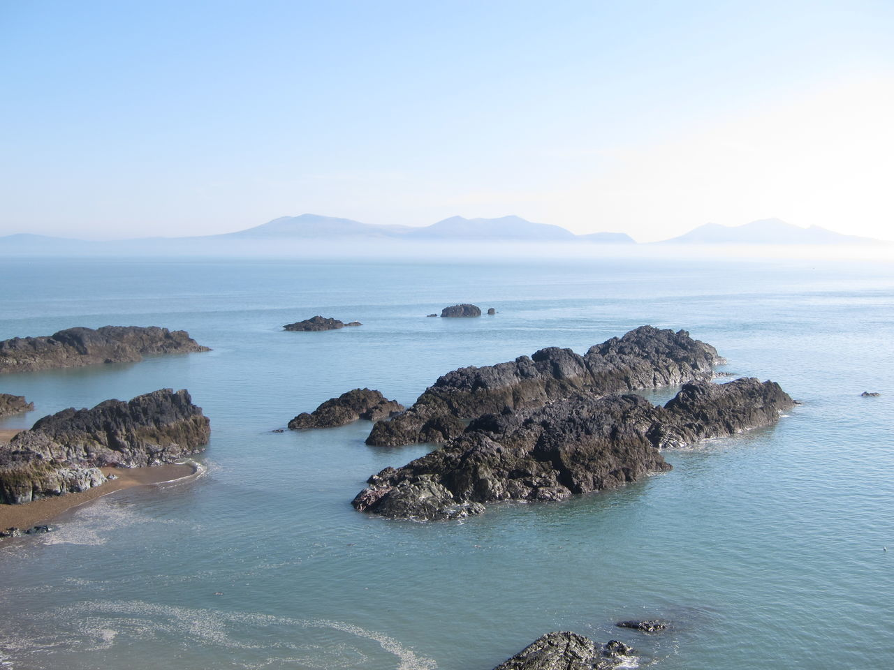nature, rock - object, sea, beauty in nature, scenics, tranquility, tranquil scene, water, no people, outdoors, sky, mountain, day